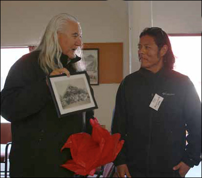 Rupene Waaka presented Navajo Indian film maker Blackhorse Lowe, a, with a photograph of the opening of the first marae meeting house in 1927, following the welcoming powhiri