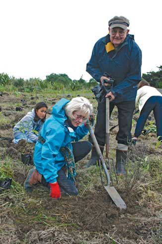 Keen environmentalists, Peter and Diana Standen were among those at the Arbor Day planting. They were busy helping with the newest area of estuary restoration.