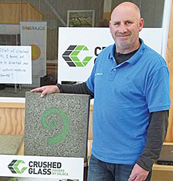 Malcolm Mason shows off crushed glass pavers made by Ōtaki firm Silaca