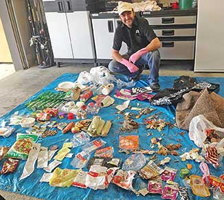 James Cootes with the contents of one rubbish bag that was left at Ōtaki Beach