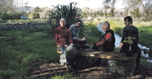 Taking a break on the new seat at the Pub Charity Planting, Gloria Thurley, Pauline Morice, Margaret Bayston and Joey Hall. The seat was constructed by members of KPMG Accountants, who also planted the carex grass along the Waimanu Stream behind the seat