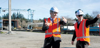 The M2PP project precast project manager, Jonty Pretorious right shows Otaki MP  Nathan Guy where some of the changes to the precast concrete site will be made. Sixty per cent of the concrete works for the McKays to Peka Peka section of the Expressway will be built at the Otaki site