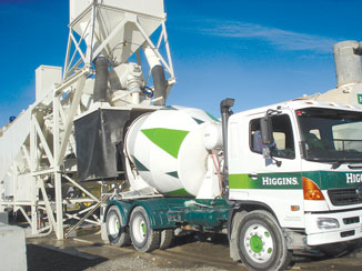 The new plant pours concrete into a Higgins truck  for its journey to the expressway