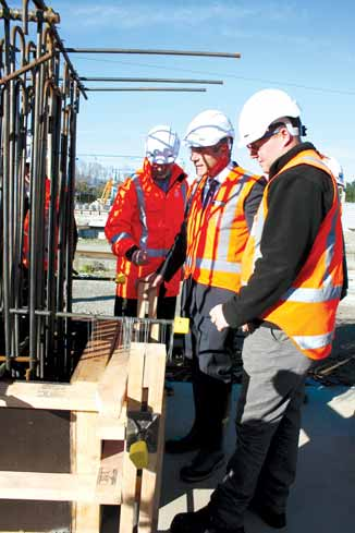 Nathan Guy, MP for Otaki centre, views the trial steel reinforcing cage in preparation for moulding the huge bridge beams on the McKays to Peka Peka section of the expressway at the Otaki precast concrete site