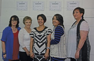 The four lucky girls with their new look, after their makeover at Chairs Hair Design, from left Howie Sampson, Janine Taratoa, Chairs owner Melanie Woodmass, Becky Cowan and Tania Rikihana