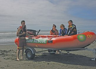 Otaki Surf Lifesaving Club's lifeguard, Lee Doyle and Nicky Chatterton with junior lifeguards Damien Doyle and Alex Lundie, prepare to launch the IRB they won in the BP Click for You Club competition