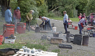 Fire, smoke, blokes in gloves and pots galore!