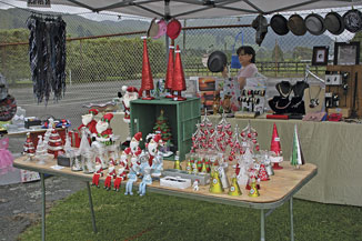 Christmas decorations, novelties and gifts for sale on one of the many stalls selling Christmas themed goodies