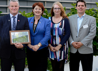 Conservation Minister Maggie Barry (centre) with Energise Ōtaki stalwarts Andy Fraser(with award), Sue Hurst & Leigh  Ramsey