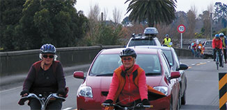 """Cyclists ride two abreast and """"take the lane"""" on the Otaki River bridge in October 2010.  The bridge is too narrow for cars to pass cyclists safely. Photo by Andrew Donaldson/ Chainlinks"""
