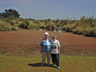 Joy Anderton & Jill Abigail on the edge of their wetland