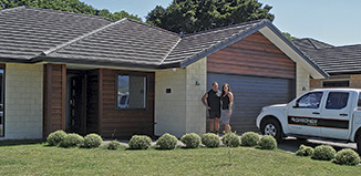 Hadley and Kylie Gardner outside the Totara park show home