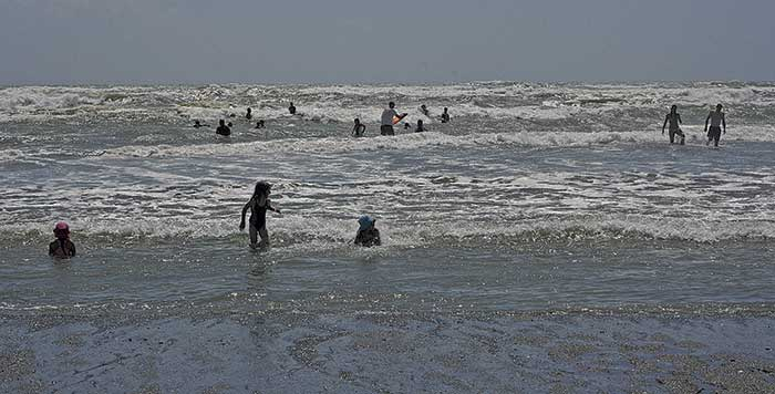 Swimmers at Otaki Beach