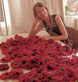Librarian Martine Backhouse with poppies made to commemorate soldiers at Gallipoli