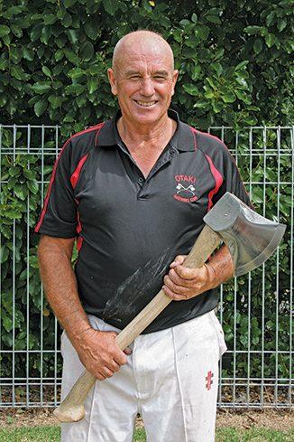 Graham Rasmussen readly to chop wood