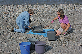Maxine and Judy Chandler sift gravel to make hypatufa