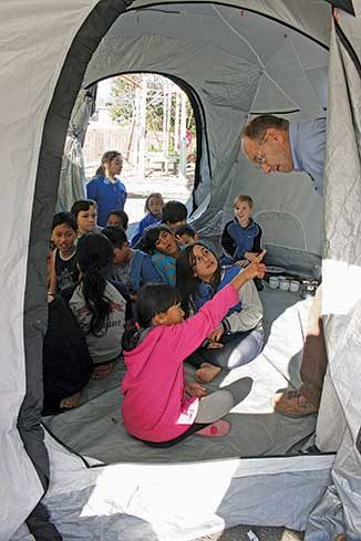 Otaki School's Room 1 pupils inside the Shelter Box tent where they were shown the contents of an emergency relief box