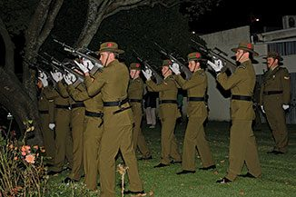 Soldiers from the 2 Signal Squadron fire a three volley round during the Anzac Dawn Parade