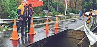 Mayor Church and Councillor Gaylor assess damage to Ringawhati Rd bridge.