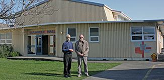 Otaki Anglican Parish vicar Ian Campbell and property manager Ralph Richardson outside Hadfield Hall. The parish and community hall is looking a bit tired and in need of urgent refurbishment