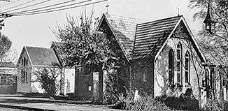 To the left of All Saints' Church is the Parish Hall which had been built in Iti Street ( no 12) in 1904, as a Church Room for Sunday School and socials. In 1914 the buiilding was transferred to Te Rauparaha Street to be used as a church. The building was demolished in 1962 to make way for the building of Hadfield Hall.