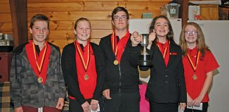 Mastermind top team Te Horo School's A team: Patrick Joss, Emma Joss, team captains Jacob Walker and Peyton Morete with the winner's cup and Paige Cull (Click for full size)
