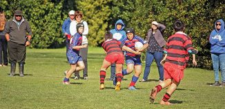 the Rahui player with the ball is Heremaia Cooper, to his right is Dayton Hakaraia.This was an U11s match Rahui vs Poneke, which Poneke just won. (Click for full size)