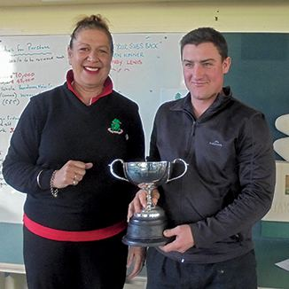 President Bella Ansell presents the Trophy to Senior Champion Johno Benner