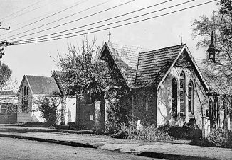 To the left of All Saints' Church is the Parish Hall which had been built in Iti Street ( no 12) in 1904, as a Church Room for Sunday School and socials. In 1914 the buiilding was transferred to Te Rauparaha Street to be used as a church. The building was demolished in 1962 to make way for the building of Hadfield Hall. (Click for full size)