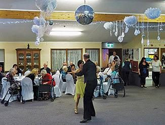Ballroom dancers Emily Kohing and Alan Field entertain guests at the Reevedon Rave