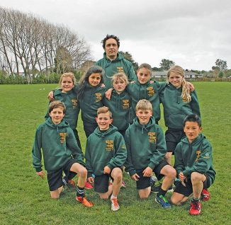 "Above right: Waitohu School's A rippa rugby team, winners of the Interschool Rippa Rugby Tournament and  earlier the Horowhenua/Kapiti year 5-6 Rippa Rugby Tournament and the opportunity to play at the National ""World Cup"" tournament. The team included: Fletcher Carpenter,Letisha Royal-Meyer-Strawbridge, Braithan Collins, Maia O'Connor, Raymond Su,Gracie Cootes, James Lei, Ambara Hussain, Ben Warrington, Georgia Humphreys and coach Kahura Cameron (Click for full view)"