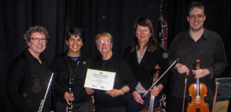 Earlier this year the Kapiti Concert Orchestra was honoured to receive a Community Award at Kapiti's Annual Wellington Airport Community and Civic Awards event. Members of the Kapiti Concert Orchestra with their Community Award. L to R: Joanna Devane, Angela Ford, Frances Tull, Suzanne Priestley, Josef Griffiths.