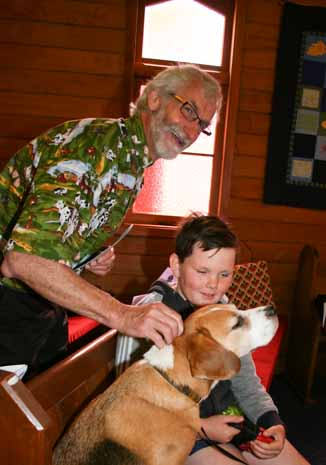 "Ben seems to be enjoying the caring touch of Vicar Ian Campbell during his own blessing ""scratch a little higher please"" to the amusement of visitor Thomas Andrews, at the St Margaret's Church St Francis Pet Blessing service. At home with his ""people slaves"" Anne Keeble and Peter Rahr, he's teaching them to play fetch!"