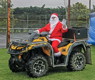 Unable to catch his reindeeer, Santa turned up at the Te Horo Christmas fair on his bike. Hardly traditional!