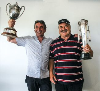 Barry Lichter (left) with the Wellington Trotting Cup while Steve Hollander holds high the Ōtaki Trotting Cup after achieving the double victory at the Ōtaki trots