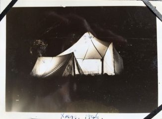 1946. Tilley lamps light the tents at night. The Christmas after my parents married they went on holiday with my grandparents. They had the small tent as a bedroom.