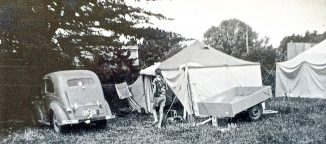 A car, a trailer and a tent: camping required enough prosperity to afford these. My parents began camping as a family in 1954, six years after they married. Maketu, 1957.