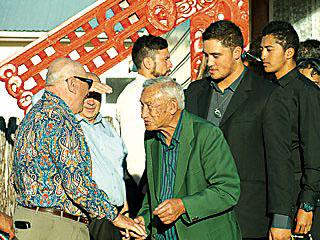Mauriora Kingi's cousin Akuhata Akuhata shares a joke with old acquaintance Te Ariki Morehu from Te Arawa. Photo by Whare Akuhata